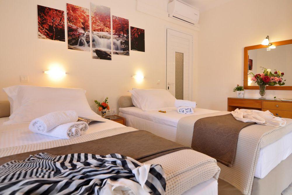 2 single beds rolandos accommodation